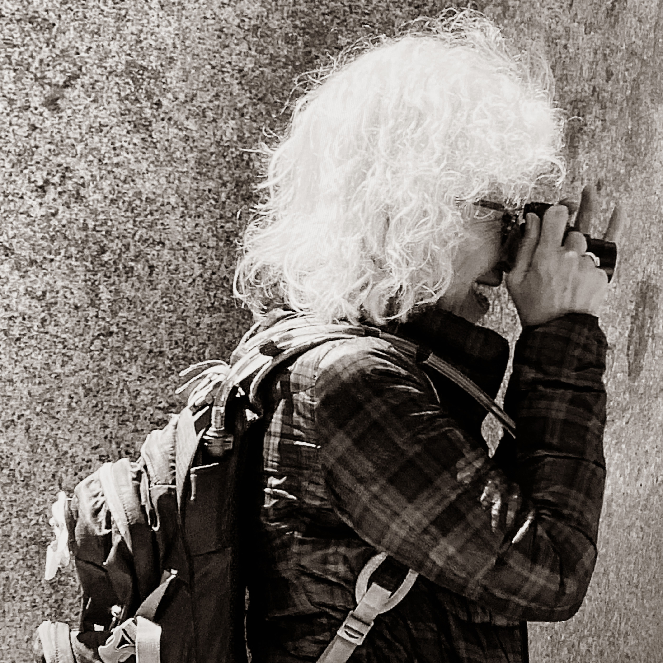 Donna Bassin photographing with camera as artist portrait
